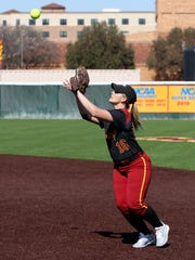 Midwestern State second baseman Samantha Loos catches
