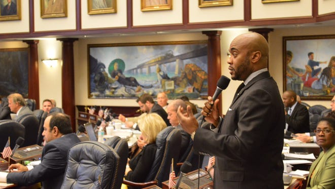 State Rep. Alan Williams, D-Tallahassee, discusses financial issues Thursday on the House floor during debate on a $436 million tax-cut package.