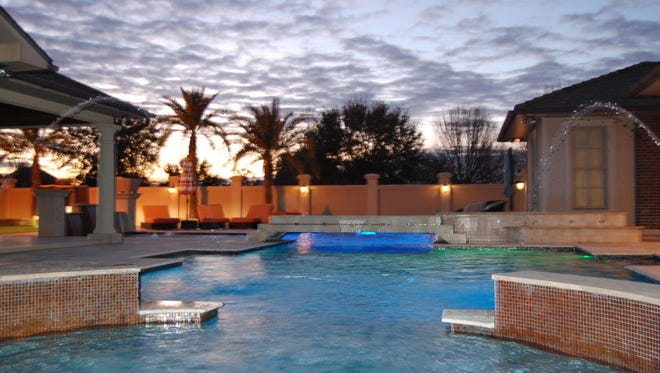 Lighting adds to the atmosphere of this gorgeous pool