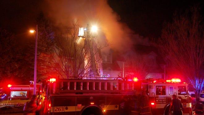 Firefighters battle a blaze Wednesday night in Norwood.