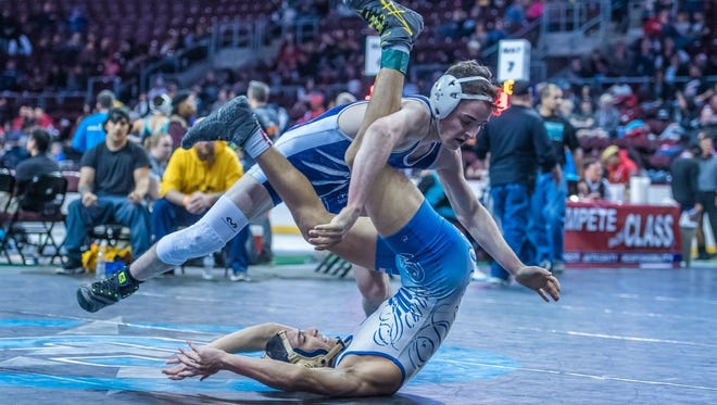 Piedra Vista's Wes Rayburn, top, wrestles Santa Fe's Alex Abeyta during the 6A state championships on Friday at the Santa Ana Star Center in Rio Rancho.