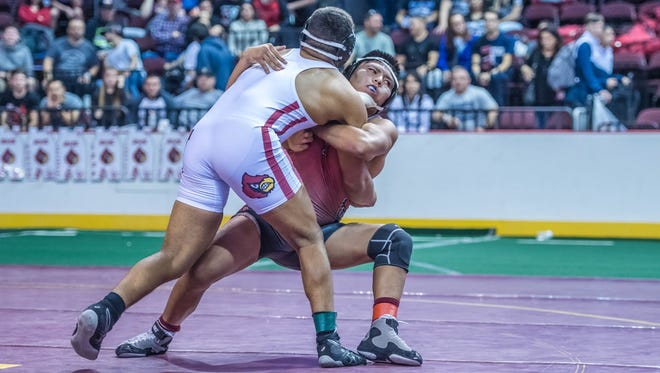 Shiprock's Logan Charley, right, wrestles Robertson's Darian Duran during the 195-pound championship match on Saturday at the Santa Ana Star Center in Rio Rancho.