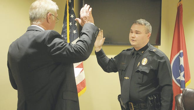 Jason Oliver is sworn in as Medina Police Chief by Mayor Vance Coleman on Monday, March 6.