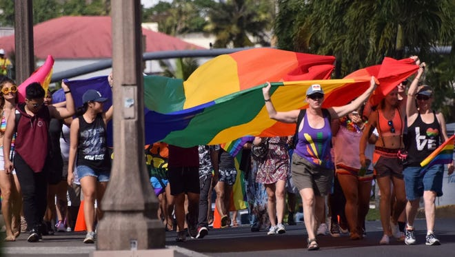 Guam Pride and their supporters take the LGBTQ Flag to the streets of Tumon for Guam's first major pride march on June 10, 2017.