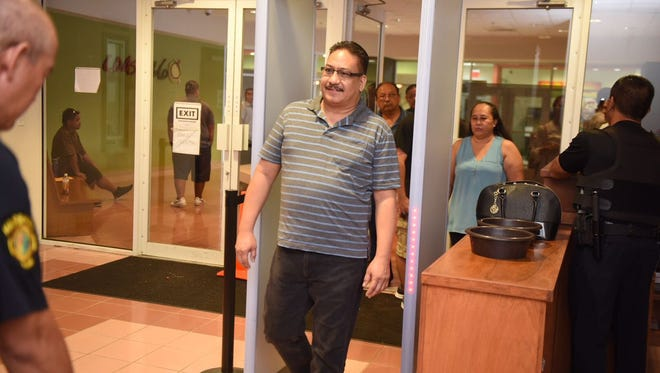Mark Charfauros, who was demoted and fired from the Guam Police Department this year, arrives for an arraignment hearing for his criminal case at the Superior Court of Guam Northern Court Satellite on Aug. 9, 2017. Charfauros is facing charges of obstructing government operations and two counts of official misconduct, all as misdemeanors.