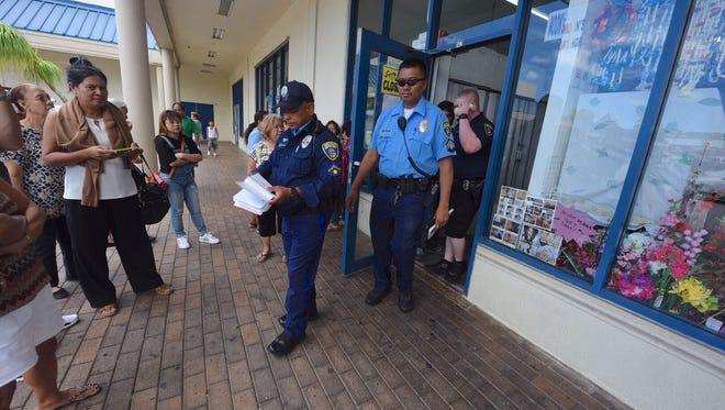 Police officers were on scene and vendors and customers were outside the People's Bazaar I at the Compadres Mall Wednesday, Aug. 16, 2017.