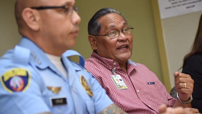 Department of Corrections Director Tony Lamorena, right, speaks at a joint press conference held by the Guam Police Department and DOC on Thursday, Aug. 27, 2017.
