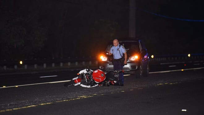 A Guam Police Department officer investigates the scene of a serious motorcycle accident in Yigo Monday.