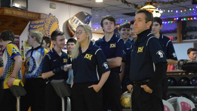 Kettle Moraine High School bowling team member Stephanie Handford (left) watches the action while her coach Jamie Soneberg (right) and other members of the KM team behind them look on at Jay's Lanes in Mukwonago.