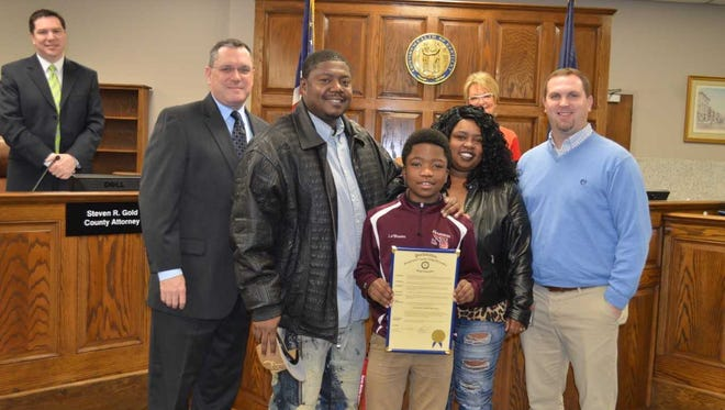 Pictured: Brad Schneider, Judge Executive; Robert Lewis, father; LeShawn Robinson, student; Tamika Lewis, mother; Bruce Farley, guidance counselor