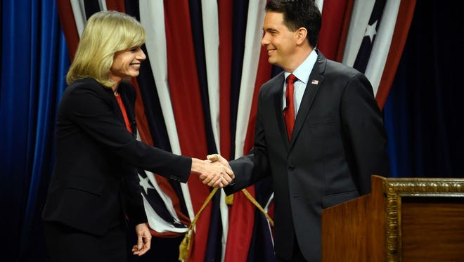 Wisconsin Republican Governor Scott Walker, right,  shakes hands with Democratic challenger Mary Burke before a televised debate Friday, Oct. 17, 2014, at the WMVS-TV studio in Milwaukee.