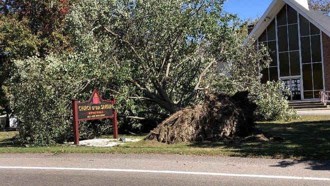 A tree came down last week in front of Church of Our Savior in Somerset during a powerful windstorm that weather officials are calling a derecho.