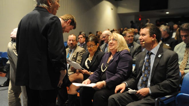 Trustee Vice President Barbara McLaury chats with, from left, Superintendent Pedro Martinez and trustees Barbara Clark, Estella Gutierrez and Dave Aiazza, prior to the State of Education address by Martinez at Reno High School in January 2014.