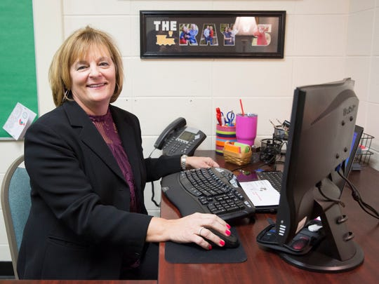 Kathy Ray, a retired MCS administrator, sits behind