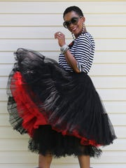 "Lauren Simmonds wears a black and white striped ""More Love"" T-shirt by Blacktag Apparel; black tulle outer skirt by Chic Wish, with two tulle petticoats for extra volume; and Stuart Weitzman Crush ankle boots from Neiman Marcus."