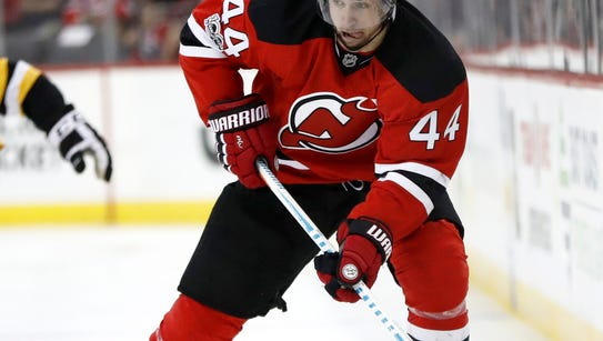 New Jersey Devils left wing Miles Wood skates against