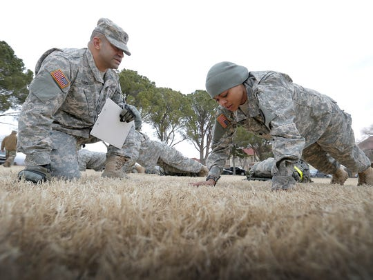 Spc. Christy Sudler, of Fort Riley, Kan., does push-ups