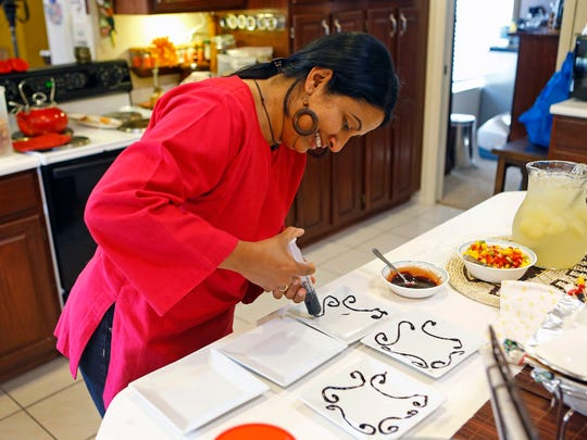 Shereen Thomas prepares dessert  for the Top Home Chef  contest.