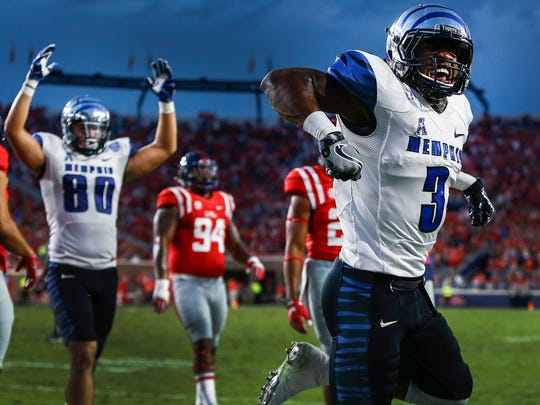 Memphis receiver Anthony Miller (right) celebrates a 7-yard touchdown run against Ole Miss during a 2016 game at Vaught-Hemingway Stadium in Oxford, Mississippi