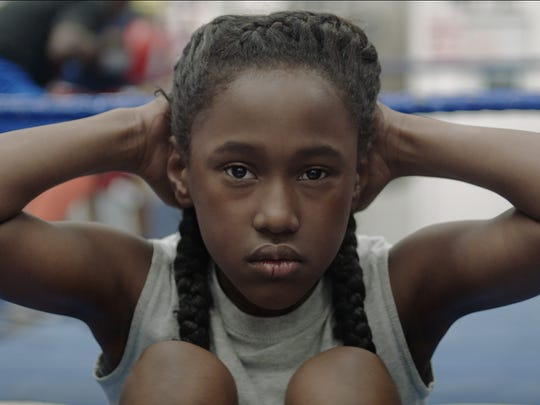 "The opening scene of ""The Fits"" features local student Royalty Hightower as Toni."