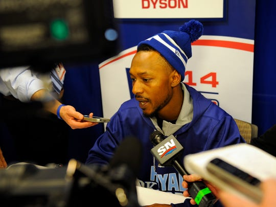 Oct 20, 2014; Kansas City, MO, USA; Kansas City Royals center fielder Jarrod Dyson (1) talks with members of the media prior to practice the day before the start of the 2014 World Series at Kauffman Stadium. Mandatory Credit: Christopher Hanewinckel-USA TODAY Sports