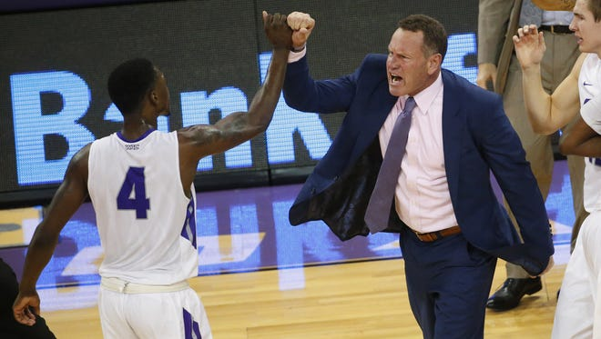 Grand Canyon University forward Oscar Frayer (4) slaps hands with head coach Dan Majerle in the game against San Diego State at GCU Arena in Phoenix, Ariz. December 7, 2016.
