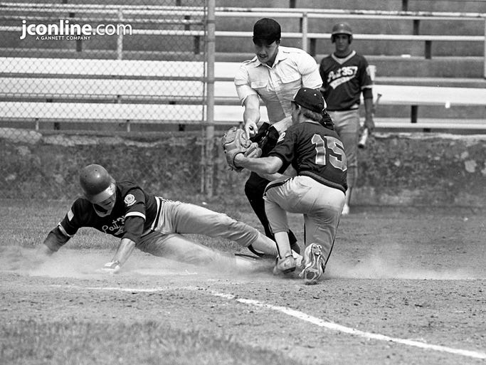 South Bend American Legion Post 357's Kevin Eastman, left, is tagged out at the plate by Lafayette Post 11 pitcher Tim Freels in Loeb Stadium during the first game of a doubleheader. Post 357 swept Lafayette, 2-1, in eight innings, and 3-2 in nine innings. Photo taken June 23, 1984.
