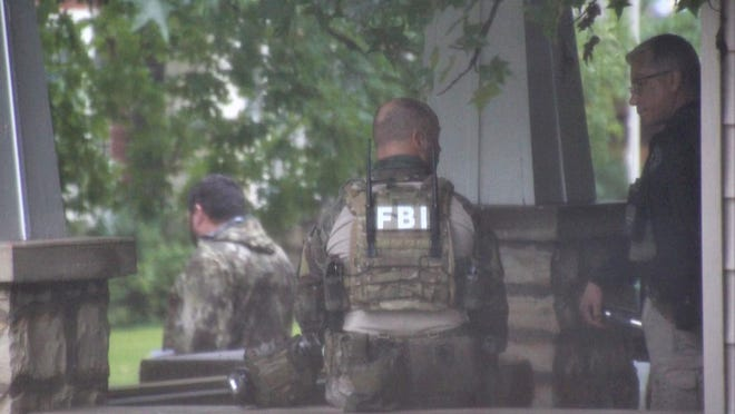 FBI agents execute a warrant from a federal indictment charging people in the Fort Smith region in a multi-state drug trafficking and money laundering conspiracy on Thursday, Sept. 10, 2020, in Heavener.