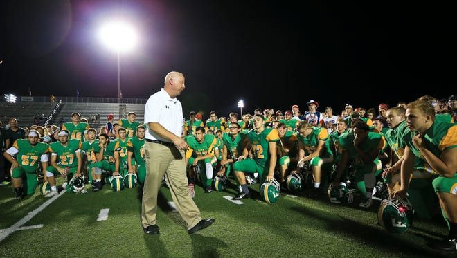 Floyd Central football coach Brian Glesing addressed his team after win over Providence Aug. 25.