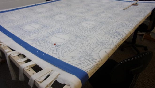 An 89-year-old quilt is being repaired  at the J.D. Lewis Senior Center.