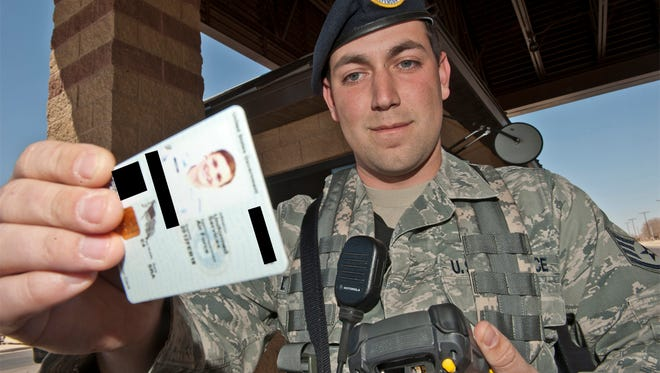 Staff Sgt. Matthew Dodson, 49th Security Forces Squadron, uses a Defense Biometric Identification System to check a government ID card, March 15, 2011, before allowing a member of Team Holloman to enter the base at the main gate. Entry-controllers work in conjunction with personnel manning the Welcome Center to identify people with outstanding warrants and prevent them from entering the base