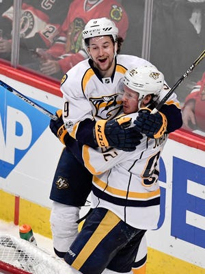 Nashville Predators left wing Filip Forsberg (9) celebrates with center Ryan Johansen (92) after Johansen's goal in the third  period of game two in the first-round NHL playoff series at the United Center, Saturday, April 15, 2017, in Chicago, Ill.