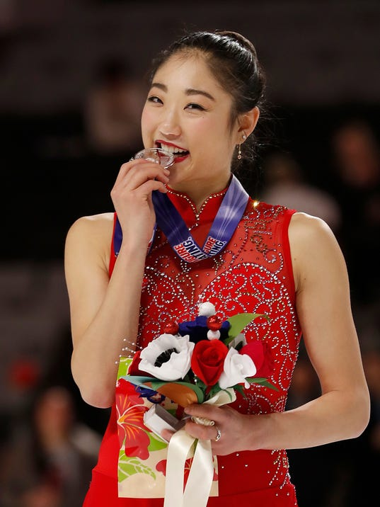 FILE - In this Jan. 5, 2018, file photo, Mirai Nagasu poses after finishing second in the women's free skate event at the U.S. Figure Skating Championships in San Jose, Calif. Nagasu is going to the Olympics eight years after finishing fourth at the 2010 Vancouver Games; no U.S. woman has done better since or is likely to in Pyeongchang. Her climb has been an extraordinary one even by the drama-filled standards of the sport.  (AP Photo/Tony Avelar, File)