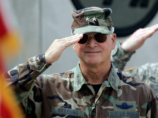 Maj. Gen. Al Wilkening, who was the commander-in-chief of the Wisconsin National Guard from 2002 to 2007, salutes the colors during the National Anthem during a send off ceremony for the 1157th Transportation Company during a send off ceremony September 5, 2006 at the Joint Forces Maneuver Center at Camp Atterbury, Ind.
