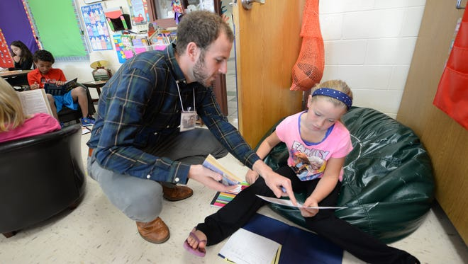 A University of Wisconsin-Green Bay student teacher works at Red Smith School in Green Bay in September 2014.