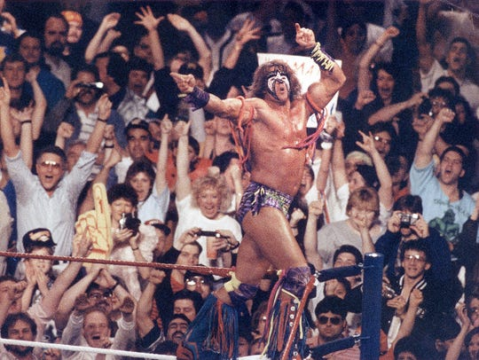 The Ultimate Warrior jumps into the ring during the