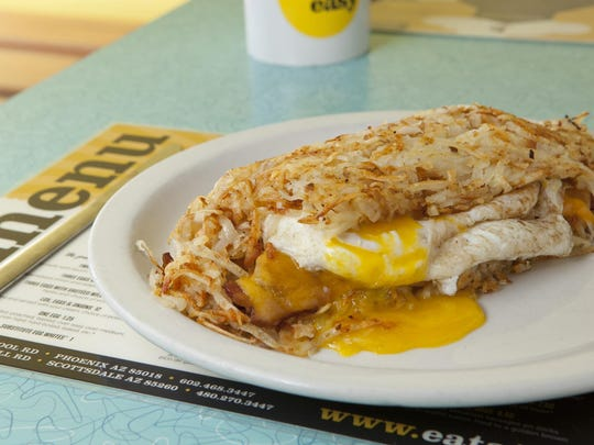 Over Easy's signature Wolfpack comprised of two eggs, bacon and cheese stuffed between two hash brown layers.