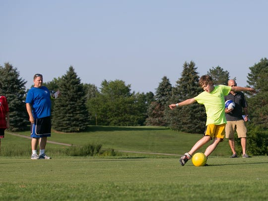 Riley Creswell, 12, of Canandaigua, tees off during a round of footgolf at Victor Hills Golf Club in Victor on Monday. The game is played on golf courses, and requires players to kick a soccer ball into a large hole.