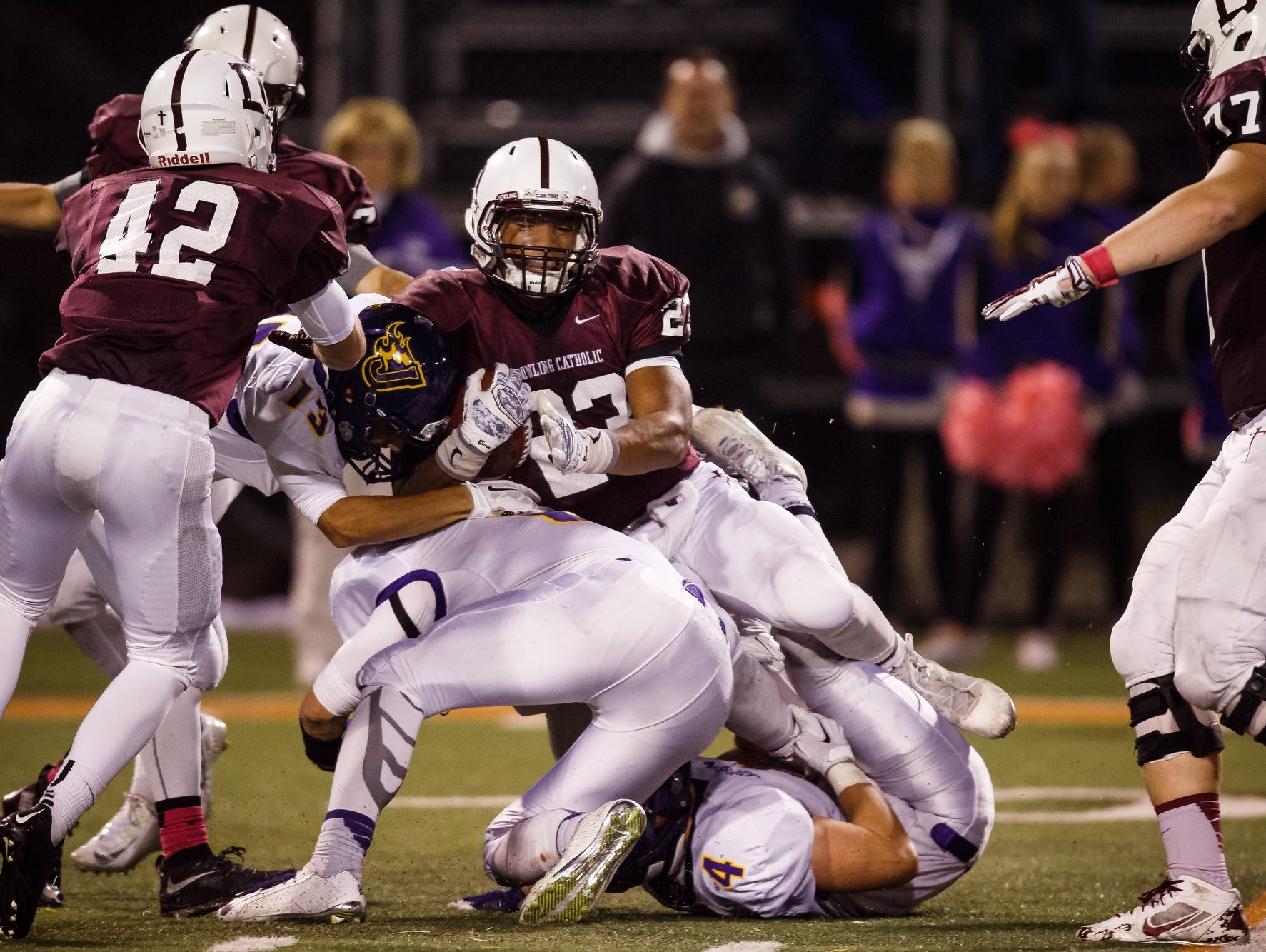 Dowling Catholic's Jacob Zachary leans for extra yardage during their game their game against Johnston at Valley Stadium in West Des Moines on Friday, October 9, 2015. Dowling Catholic would go on to win 35-15.