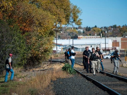 GFPD officers clear the area near Stockman Bank on