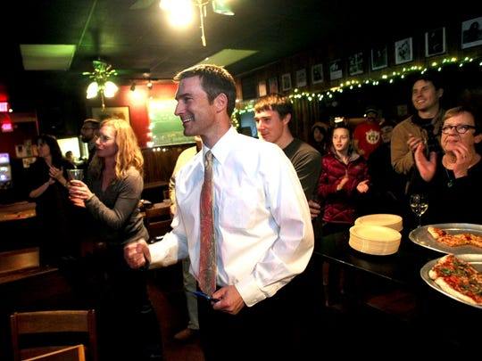 Matt Hayek celebrates his election to another term as Iowa City Mayor at The MIll Restaurant on Tuesday, November 8, 2011.