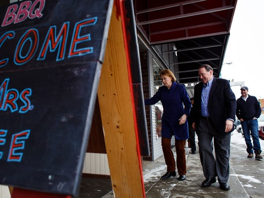 Republican presidential candidate Mike Huckabee and his wife Janet walk into Moo's BBQ in Newton for a campaign stop  at 11 a.m. Tuesday, Jan. 26, 2016.