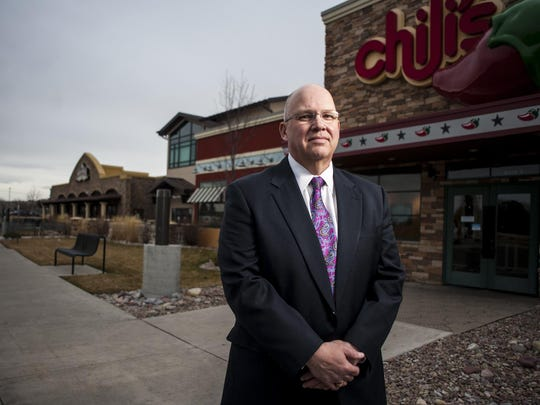 Top: Commercial Realtor Mark Macek stands outside three Marketplace restaurants owned by Shoot the Moon. Macek was appointed by a bankruptcy court to sell the properties after the company filed to reorganize its debt under bankruptcy last fall.