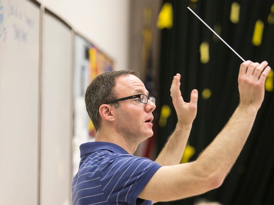 "Award-winning composer and conductor Brian Balmages, leads fifth- and sixth-grade band practice Wednesday, March 16, 2016, at Spring Grove Intermediate School. Balmages composed ""Tears of Arizona"", which was written in honor of the 75th anniversary of the sinking of the Arizona in Pearl Harbor, HI. The fifth- and sixth-grade band, will play ""Tears of Arizona"" publicly for the first time during a concert, held at the school on March 31, and then again in Washington D.C in May. Amanda J. Cain photo"