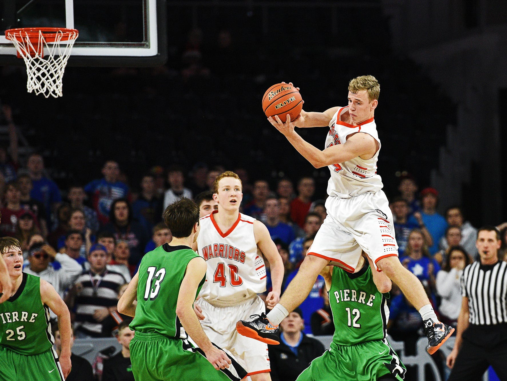 Washington's Logan Uttecht (24) pulls down a rebound during a South Dakota Class AA State Boys Basketball Tournament semifinal game against Pierre Friday, March 18, 2016, at the Denny Sanford Premier Center in Sioux Falls. Washington beat Pierre 61 to 57.