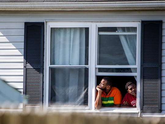 Neighbors watch as officers investigate after a standoff with a man who, according to a source close to the investigation, was threatening to kill himself after killing his girlfriend in a home along Freedom Trail on Tuesday afternoon.