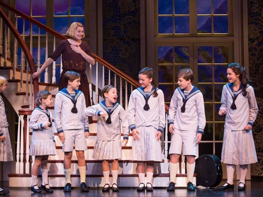 """Do Re Mi"": Kerstin Anderson as Maria Rainer and the von Trapp children. From left: Svea Johnson (Brigitta), Audrey Bennett (Gretl), Quinn Erickson (Kurt), Mackenzie Currie (Marta), Maria Knasel (Louisa), Erich Schuett (Friedrich), Paige Silvester (Liesl)."