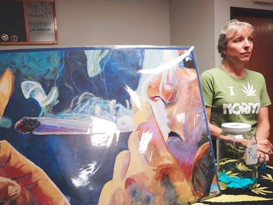 Regan Hall takes raffle tickets for the large painting which will be raffled off at the end of the service of the First Cannabis Church of Logic and Reason Sunday, June 26, 2016.