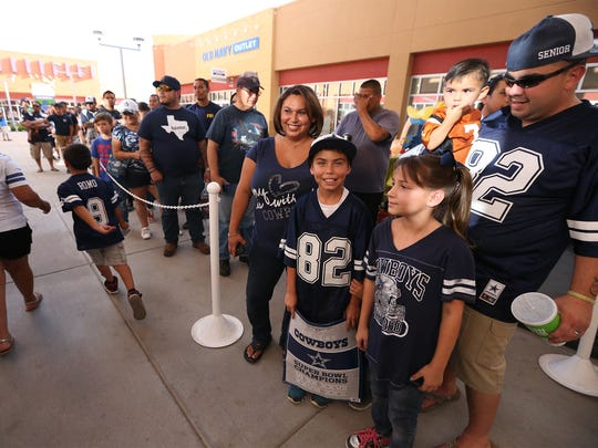 Dallas Cowboys fans wait to get into the Dallas Cowboys Official Pro Shop to see Rowdy, the official Cowboy's mascot, Friday at The Outlet Shoppes at El Paso. Cowboys reporter Mickey Spagnola and official bus driver Emory Tyler were also on hand.