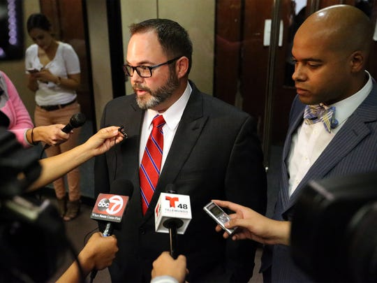 Justin Underwood, left, lead defense attorney, speaks to the news media after a jury found his client, Adrian Garcia, not guilty in the 2013 death of his girlfriend, Alejandra Arango, on Wednesday in 384th District Court. At right is co-defense attorney Tommy Carter.